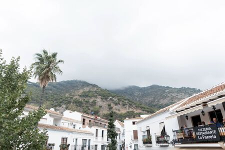 View of the old village of Mijas and the mountains with trees. Costa del Sol. Andalusia. Spain