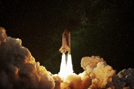 Space Rocket takes off into space. The concept of a successful journey on a spaceship to other planets. Starry sky with shuttle