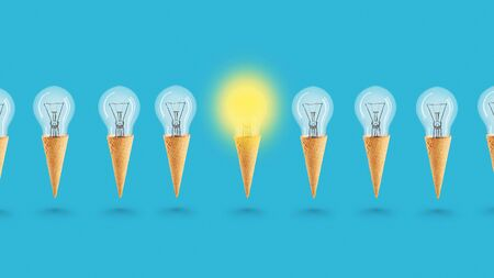 Idea concept with light bulbs and ice cream on a blue background. Light bulb in a waffle cone. Art