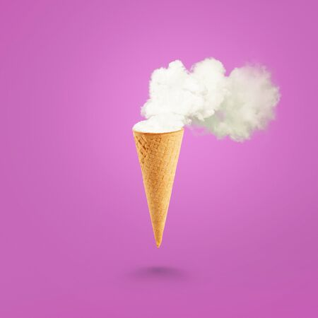 Ice cream cone and white smoke on pastel pink background. Flat lay. Global warming concept. Stock Photo - 140097955