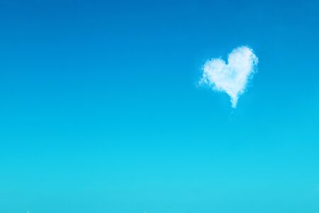 Heart cloud on a blue sky. Good weather concept. Love in heaven. Creative minimalism