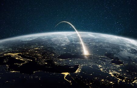 Rocket launch on a night planet earth with lights. Concept of successful satellite launch. Spaceship flies over the planet. View from space Foto de archivo