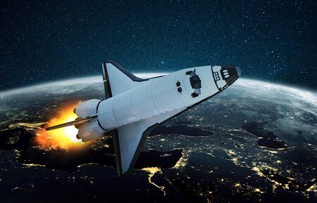 Space shuttle fulfills a mission in outer space. Rocket flies on a starry background