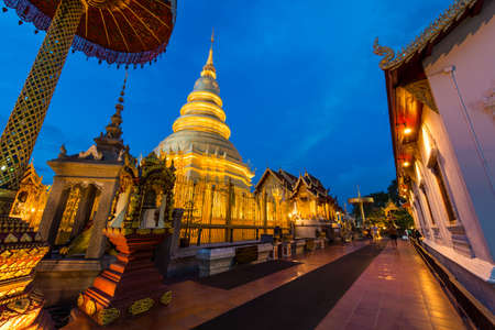 that: Wat Phra That Hariphunchai in twilight time