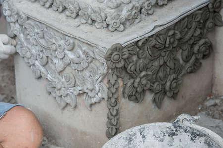 sculpting: Molding and Sculpting on the entrance construction at Wat Sanpayang Luang, Lamphun, Thailand
