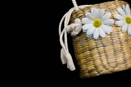 Basket weave with white flower and white rope on black background