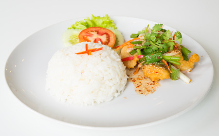 Hot and sour fried fish salad. (Thai fusion and healthy food) photo