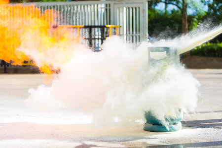 How to use a fire extinguisher with  gas container during training. photo