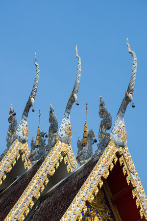 apex: Beautiful gable apex on the roof of royal temple in Phre, Thailand..