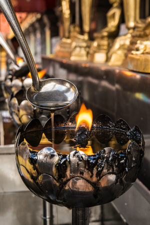 The oil lamps in a Buddhist monastery, beliveable of Buddish refill oil in pot give to lucky.