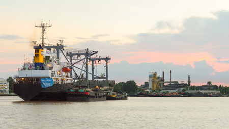 Logistic ship and Old vintage barge carrying delivering cargo across the Chao phraya river, Bangkok, Thailand Editoriali