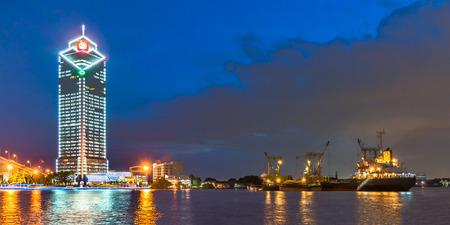 Logistic ship waiting cargo at the Chao phraya river, Bangkok, Thailand Editoriali