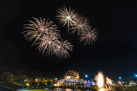 Colorful fireworks display with Royal Pavilion (Ho Kum Luang) at Rajapruek Royal Park, Chiangmai, Thailand