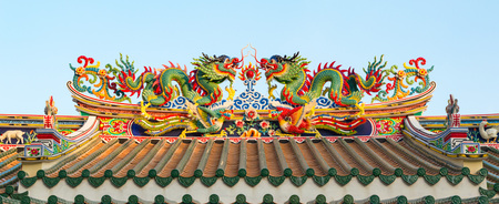 Chinese dragons on a temple roof in Thailand.