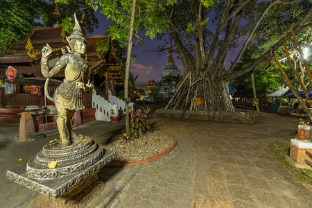 Angel Statue at Wat Kan Thom. Wat Kan Thom is the most beautiful temple in Wiang Kum Kam (Ancient Lost City in Chiang Mai, Thailand) 免版税图像