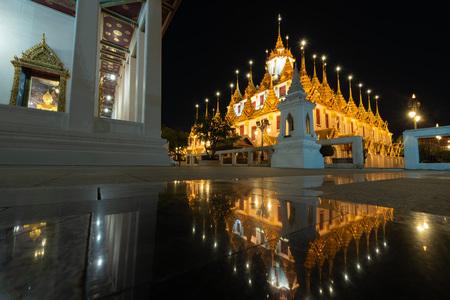 Reflection of Wat Ratchanatdaram and Loha Prasat Metal Castle (Bangkok ,Thailand) Editoriali
