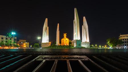 Democracy Monument at night in Bangkok.