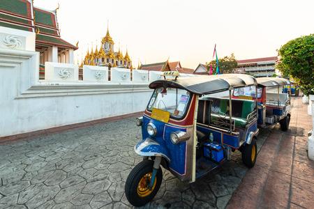 Tuk Tuk is parking in front of Wat Ratchanatdaram or Loha Prasat, Bangkok, Thailand.