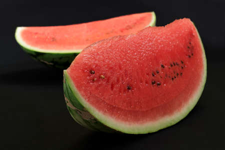 afters: Waremelon slice on dark screen