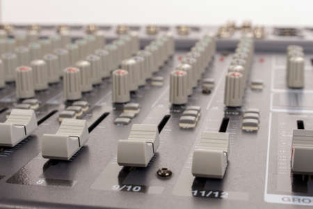 audiovisual: Close-up of audio mixing board sliders Stock Photo