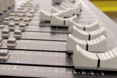 equalize: Lateral view of audio mixing board sliders Stock Photo