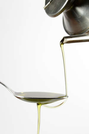 cruet: Pouring extra-virgin olive oil from a typical cruet Stock Photo