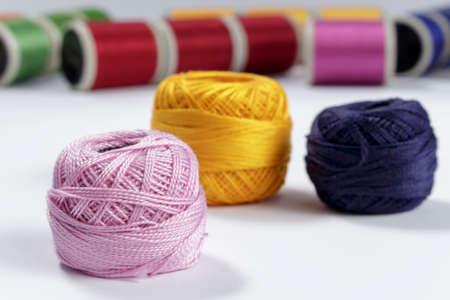 cotton thread: Skein of pink cotton thread in foreground Stock Photo
