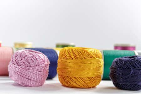 cotton thread: Skeins of cotton thread pink, orange and dark-blue