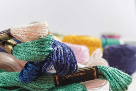 cotton thread: Close-up of stranded cotton thread light pink, green and dark blue Stock Photo