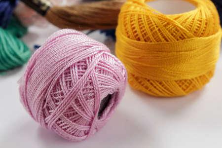 cotton thread: Close-up of skeins of cotton thread pink and orange