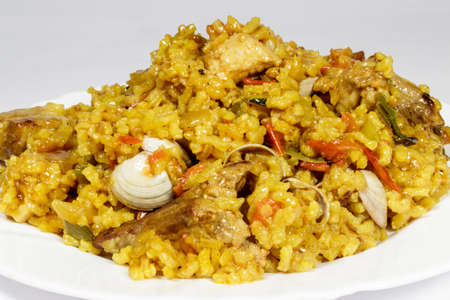 valencian: Dish of valencian paella with clams and ribs Stock Photo