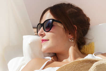 balinese: Close-up of smiling young woman lying on a balinese bed Stock Photo