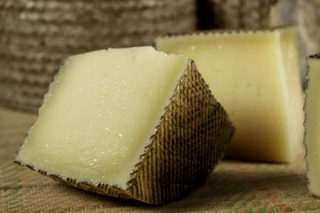 Pieces of sheep milk cheese Stock Photo