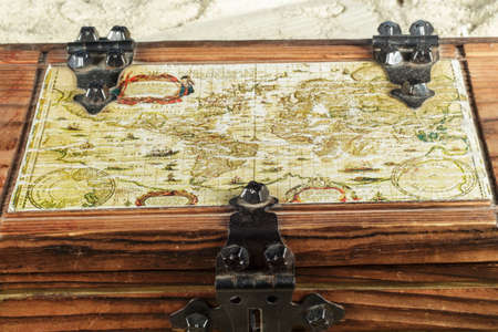 coffer: Old map embedded in the top of a wooden box