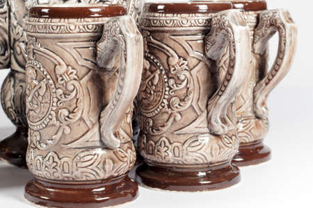 embossed: Several pitchers of beer with embossed decoration