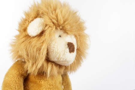 cuddly toy: Side view of plush lion on white background Stock Photo