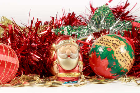 christmastide: Figurine of Santa Claus and other holiday decorations Stock Photo