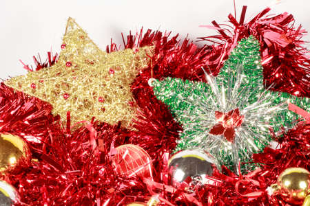 christmastide: Christmas tree stars beside other decorative pieces