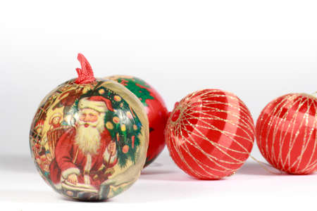 christmastide: Christmas bauble with a drawing of Santa Claus in front of others red balls.