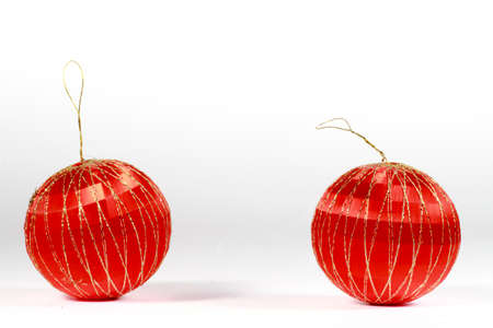 christmastide: Two red Christmas baubles on white