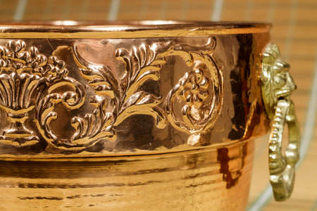 etched: Detail of engraved motifs in a cauldron of copper