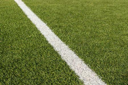 sideline: Detail of sideline in a soccer field of artificial grass