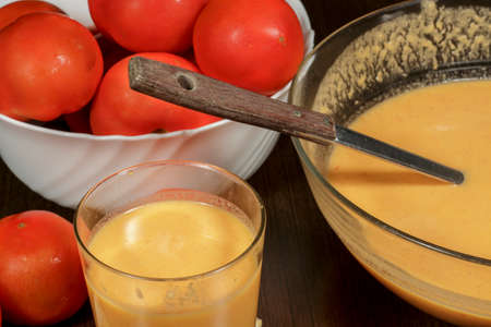 andalusian: Andalusian gazpacho beside red tomatoes Stock Photo