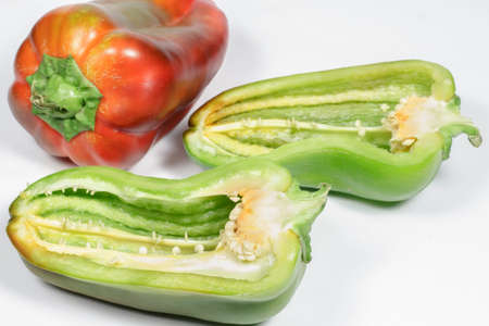 green pepper: Green pepper cut in half with other one red at background Stock Photo