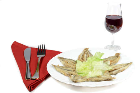 engraulis encrasicolus: Breaded anchovies and Rioja wineglass