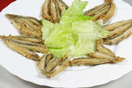 engraulis: Dish of breaded Mediterranean anchovies