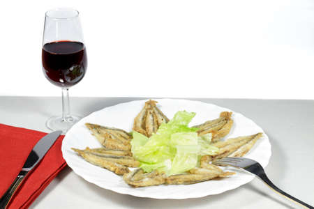 european anchovy: Mediterranean anchovies with salad and Rioja wineglass