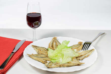 european anchovy: Dish of Mediterranean anchovies with salad and Rioja wineglass Stock Photo