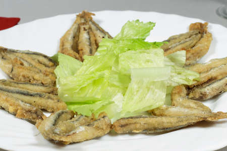 european anchovy: Dish of breaded Mediterranean anchovies with salad