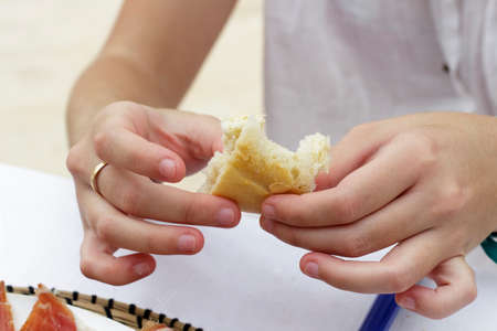 bread slice: Detail of woman hands with a bread slice Stock Photo